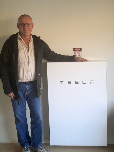 Graeme with Tesla Battery from TheEnergyExperts.com.au