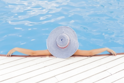 Woman relaxing in solar heated swimming pool