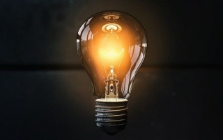Electric light bulb on dark background